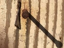 Vecchia ombra arrugginita dei it's e del chiodo Fotografie Stock Libere da Diritti