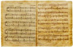 Vecchia pagina musicale delle note Fotografia Stock