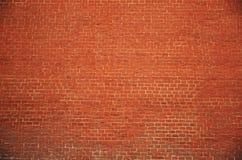 Vecchia parete arancio del blocchetto del mattone fotografia stock