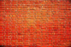 Vecchia parete arancio del blocchetto del mattone immagine stock