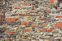 Vecchia parete dalle pietre e dai mattoni Fotografia Stock