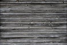 Vecchia parete di dervyannaya dei bordi stagionati Fotografia Stock Libera da Diritti