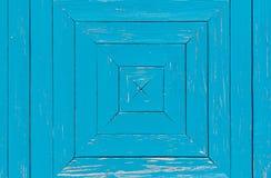 Vecchia parete di legno blu con forma quadrata nello strato Immagine Stock