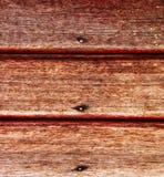 Vecchia parete di legno con i chiodi arrugginiti fotografia stock libera da diritti