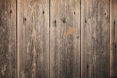 Vecchia parete di legno di marrone scuro, struttura del fondo Fotografie Stock Libere da Diritti
