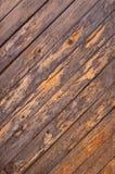 Vecchia parete di legno diagonale incrinata delle barre del fondo astratto Fotografie Stock