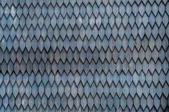 Vecchia parete di legno stagionata con l'ornamento dipinto nel gray Fotografia Stock