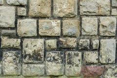 Vecchia parete di pietra con le pietre squar Fotografia Stock