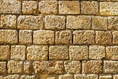 Vecchia parete medievale fatta dalla pietra Immagini Stock