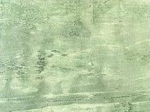 Vecchia parete verde chiaro coperta di gesso irregolare misero Struttura della superficie d'annata del nocciolo di oliva, primo p Immagini Stock