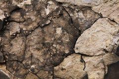 Vecchia pietra nelle crepe Immagine Stock
