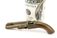 Vecchia pistola con cento fatture del dollaro Immagine Stock Libera da Diritti