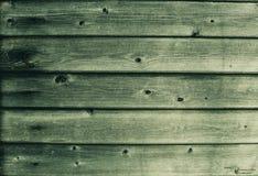 Vecchia pittura sulle plance di legno Verde fotografia stock