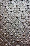 Vecchia porta con l'ornamento in parete di pietra nel castello reale di Wawel, Cracovia, Polonia Fotografia Stock Libera da Diritti