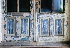 Vecchia porta insabbiata Immagini Stock