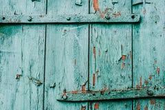 Vecchia porta verde della parte Vecchia vernice Vernice della sbucciatura Vecchio verde della parte immagine stock libera da diritti