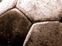 Vecchia priorità bassa della sfera di calcio Fotografie Stock Libere da Diritti