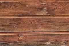 Vecchia priorità bassa di legno verniciata Plance di legno stagionate e misere dipinte nel colore marrone Immagini Stock Libere da Diritti