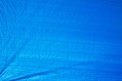 vecchia rete blu di ombreggiatura con la luce del sole nella struttura all'aperto del mercato Fotografia Stock