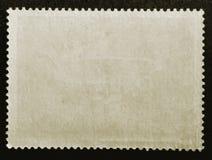 Vecchia retro inviato del bollo di struttura di lerciume carta isolato su fondo nero Fine in su Copi lo spazio fotografia stock libera da diritti