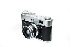 Vecchia retro macchina fotografica sui bordi di legno dell'annata Immagini Stock