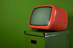 Vecchia retro televisione arancione Fotografia Stock