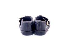 Vecchia scarpa di bambino nera fatta da cuoio Fotografie Stock Libere da Diritti