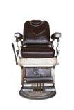 Vecchia sedia di barbiere immagini stock