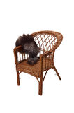 Vecchia sedia di vimini citata circa la sua gioventù Fotografia Stock