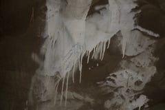 Vecchia struttura arrugginita della superficie di metallo con la pittura indossata bianca di colore Immagini Stock Libere da Diritti