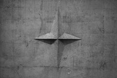 Vecchia struttura della parete Pannello grigio del cemento, stella immagini stock