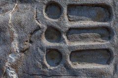 Vecchia struttura di pietra su una parete immagine stock