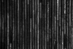 Vecchia struttura grigio scuro della parete della cabina di ceppo Parete rustica scura del ceppo della Camera L'orizzontale ha ar Fotografia Stock