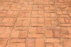 Vecchia struttura marrone-rosso del modello del pavimento del mattone immagine stock