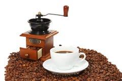 Vecchia tazza di caffè del laminatoio di caffè Immagine Stock