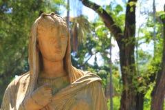 Vecchia testa della statua del metallo Immagine Stock