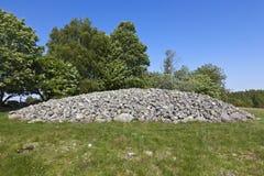 Vecchia tomba di pietra del cairn Fotografie Stock