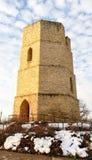 Vecchia torre di acqua di pietra nell'inverno Immagine Stock Libera da Diritti