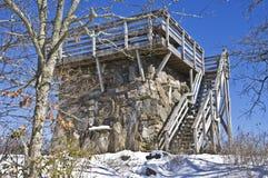Vecchia torretta di pietra dell'allerta in inverno Fotografie Stock