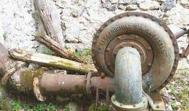 Vecchia turbina in un vecchio mulino Fotografia Stock