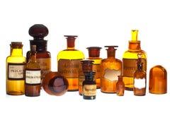 Vecchie bottiglie della farmacia fotografia stock
