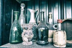 Vecchie bottiglie sporche Fotografie Stock Libere da Diritti