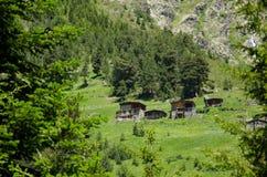Vecchie capanne della montagna Fotografia Stock