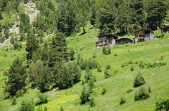 Vecchie capanne della montagna Fotografie Stock