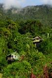 Vecchie case in colline tropicali Fotografia Stock