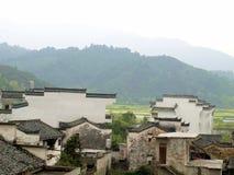 Vecchie case della montagna Immagini Stock