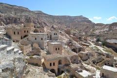 Vecchie case operate, vista della regione di Cappadocia Immagini Stock Libere da Diritti
