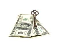 Vecchie dei dollari americani alcune e chiave banconote su un fondo bianco Fotografia Stock Libera da Diritti
