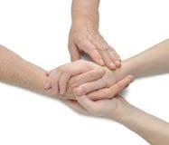 Vecchie e giovani mani; comodità d'offerta Fotografie Stock Libere da Diritti