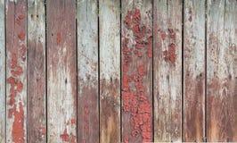 Vecchie plance di legno con i resti di pittura rossa Fotografia Stock